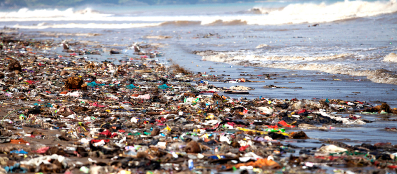 Plastic trash coming in with the tide